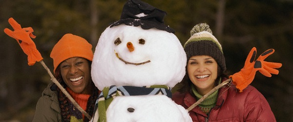 Two women with a snowman