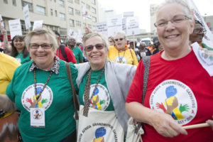 Joanne Gormley (centre) with two of the other Grandmothers to Grandmothers Campaign members who attended the South Africa Grandmothers Gathering in Durban: Elizabeth McNair (L) and Carol Little (R). By Alexis Macdonald.