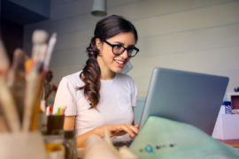 woman remote working on her laptop