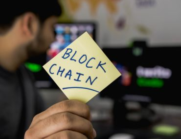 blockchain being held up by a man